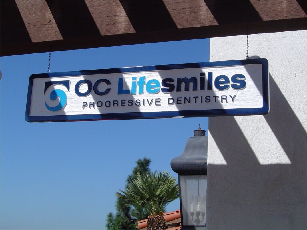 OC Lifesmiles Hanging Sign